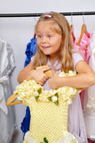 Little girl in shop of dresses Stock Photography