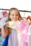 Little girl in shop of dresses. Stock Photography