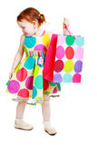 Little girl shopaholic Stock Images