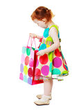 Little girl shopaholic Stock Photos