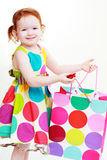 Little girl shopaholic Stock Photography
