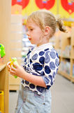 Little girl is shopping Royalty Free Stock Images