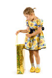 Little girl with shopping bag. Royalty Free Stock Image