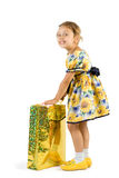 Little girl with shopping bag. Royalty Free Stock Photography