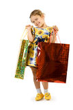 Little girl with shopping bag. Stock Photos
