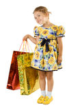 Little girl with shopping bag. Royalty Free Stock Photos