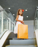 Little girl with shopping bag. In mall Royalty Free Stock Image