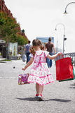 Little girl with shopping bags Stock Image