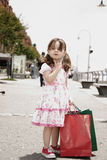 Little girl with shopping bags Royalty Free Stock Photos