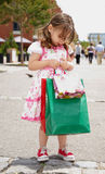 Little girl with shopping bags Royalty Free Stock Image