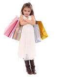 little girl with shopping bags Royalty Free Stock Photography