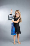 Little  girl with shopping bags Stock Images