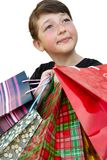 Little girl with shopping bags on white background. Little girl with shopping bags. Isolated over white background Stock Photo