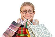 Little girl with shopping bags on white background. Little girl with shopping bags. Isolated over white background Stock Photos