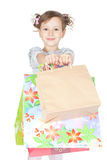 Little girl with shopping bags over white Royalty Free Stock Photography