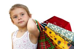 Little girl with shopping bags on white background. Little girl with shopping bags. Isolated over white background Royalty Free Stock Photography