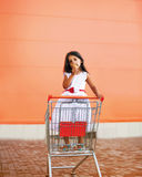 Little girl in shopping cart. With icecream Stock Photo
