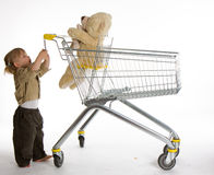 Little girl with shopping cart and Teddybear Royalty Free Stock Image