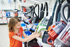 Little girl shopping for electric vacuum cleaner Royalty Free Stock Photos
