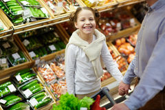 Little Girl Shopping for Groceries with family Stock Photos