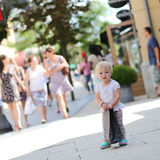 Little girl in shopping outlet village Stock Images