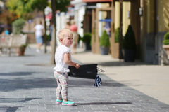 Little girl in shopping outlet village Royalty Free Stock Photos