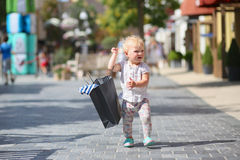 Little girl in shopping outlet village Royalty Free Stock Image
