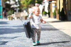 Little girl in shopping outlet village Royalty Free Stock Photo