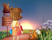 A little girl with a shoulder bag Royalty Free Stock Photo