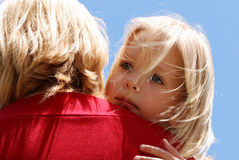 The little girl on a shoulder at mother Stock Images