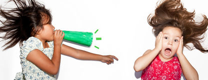 Little girl shouting at her friend. The Little girl shouting at her friend Stock Photography