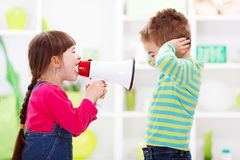 Little girl shouting loud to boy. Children playing communication - little girl shouting loud to boy Royalty Free Stock Images