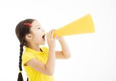 Little girl shouting by megaphone. Happy little girl shouting by megaphone Stock Photo