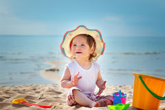 Little girl shouting at the sea with bucket. One year old girl shouting at the sea with bucket Royalty Free Stock Image