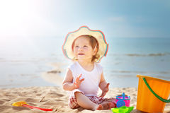 Little girl shouting at the sea with bucket Royalty Free Stock Photography
