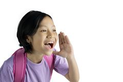 Little girl shouting in the studio. Image of little girl carrying a bag while shouting in the studio, isolated on white background royalty free stock photos