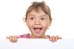 Little girl shouts across a white wall Royalty Free Stock Photography