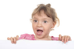 Little girl shouts across a white wall Stock Images