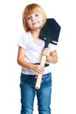 Little girl shovel Stock Images