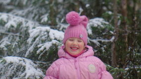 Little girl. With shovel playing in snow forest stock video