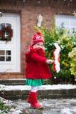 Little girl shoveling snow in winter Stock Photography