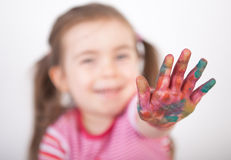 Little girl show on colored finger Stock Images