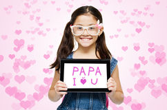 Little girl show tablet word papa I love you Royalty Free Stock Image