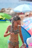 Little girl in the shower and freshen the beach in Croatia royalty free stock photos