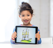 Little girl showing castle on tablet pc screen Royalty Free Stock Photo
