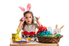 Little girl showing Easter eggs Royalty Free Stock Photos