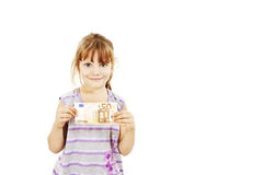 Little girl showing euro money Royalty Free Stock Photography
