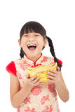 Little girl showing  gold for chinese new year Royalty Free Stock Image