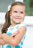 Little girl is showing grimace. While listening to somebody Stock Photos
