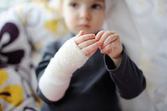 Little girl showing her bandaged hand Royalty Free Stock Image